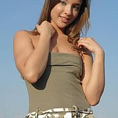 Juvenile isabella posing military-styled.