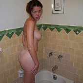 Homemade fotos of legal age teenager gal taking shower.