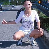 Youthful hitchhiker flashing pussy.